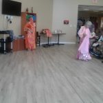 Ladies performing for the residents.