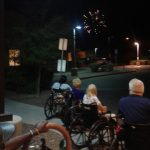 Residents watching fireworks outside.