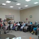 Residents listening to a band.