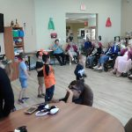 A group of children performing for Residents.