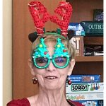 A woman with Christmas decorations on her face.