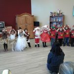 Children performing in Christmas costumes.