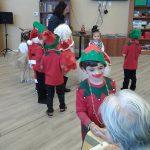 Children dancing in costumes.