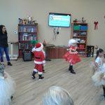 Children dancing in Christmas costumes.