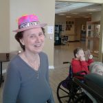 A resident with a Happy New Year hat on.