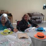 Residents decorating hats.