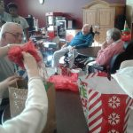Residents opening up presents for Christmas.