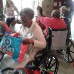 Residents opening presents.