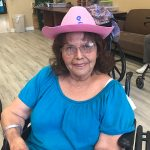 A resident wearing her pink cow girl hat.