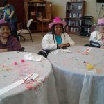 Residents wearing their decorated hats.