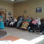 Residents watching a dancer perform.
