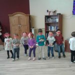 Children performing with glasses on.