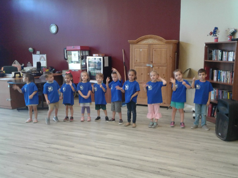 Children performing for the residents.