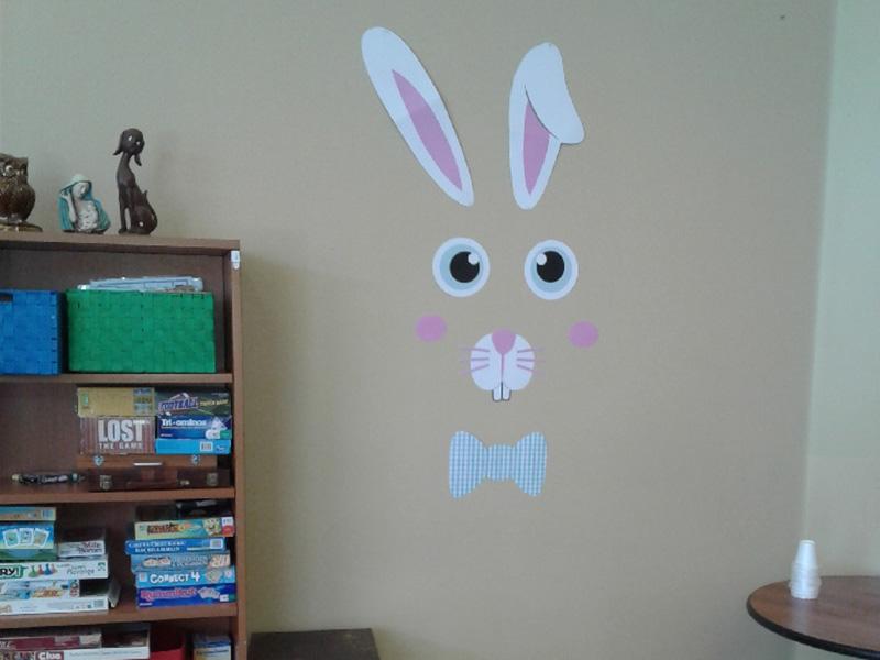 A bunny face on a wall.