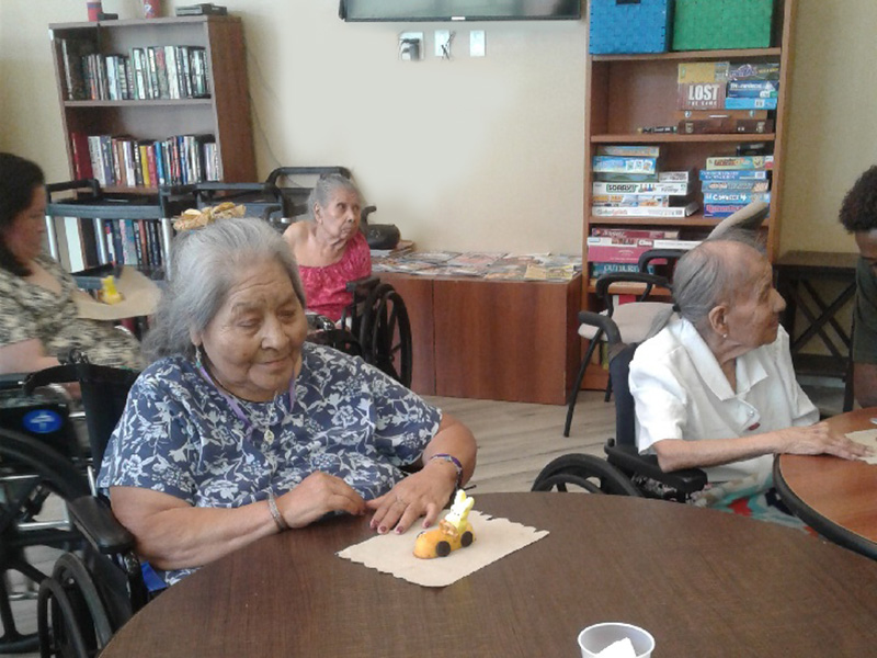 Residents looking at their edible craft.