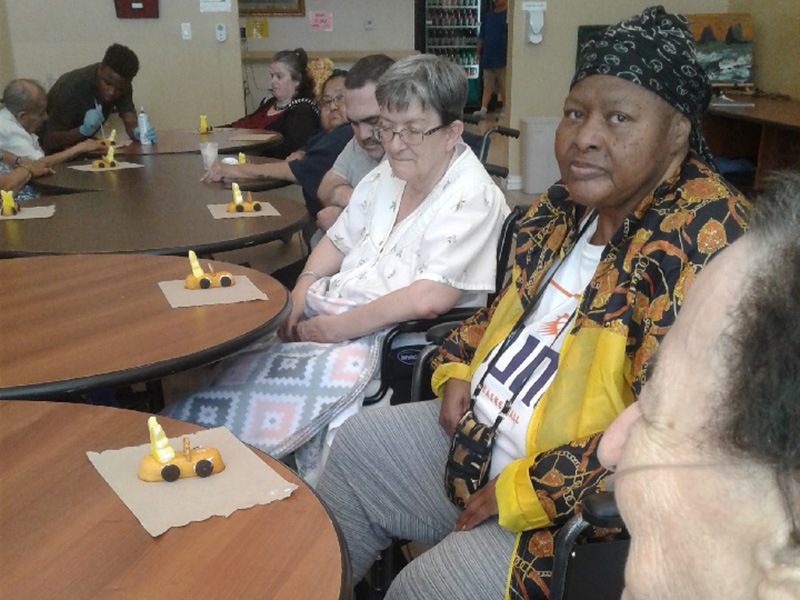 Residents working on an edible craft.