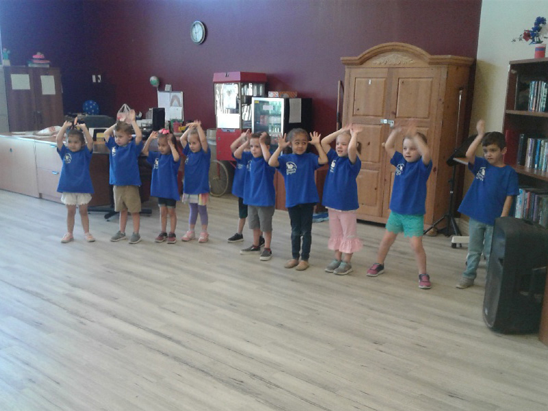 Children dancing for the residents.
