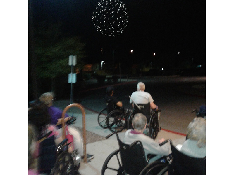 Residents watching fireworks.