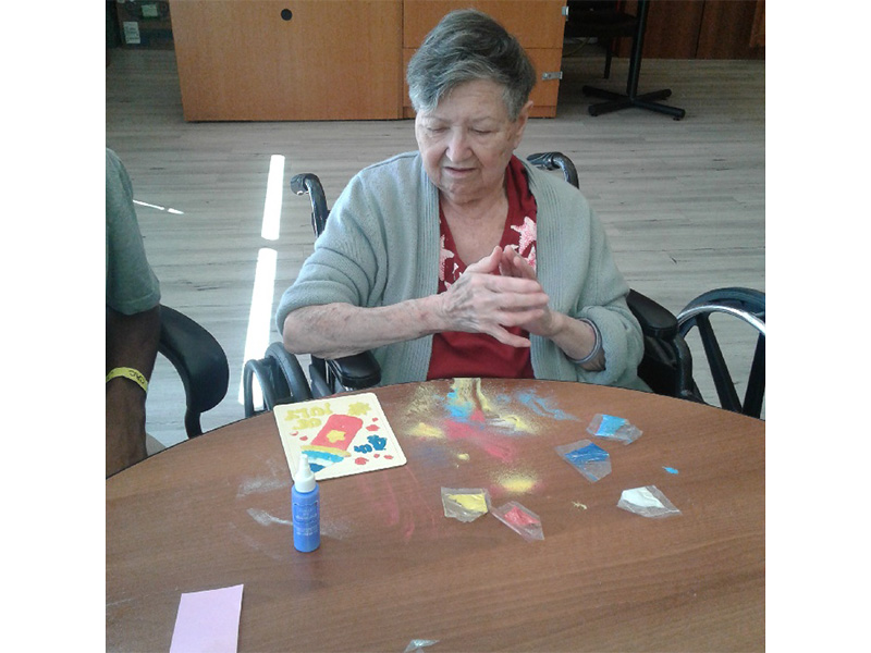 A resident crafting a card.