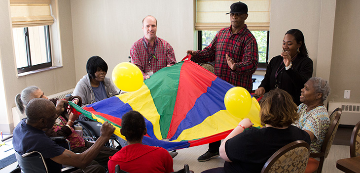 Residents playing parachute with a group