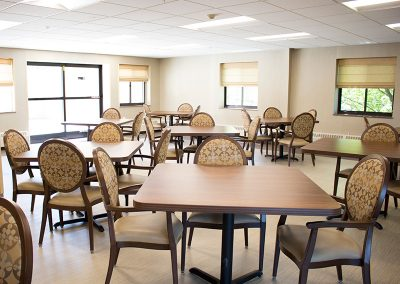 Resident dining area with clean tables, chairs and floors
