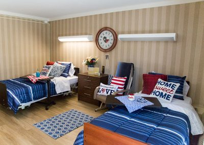 Customized resident room with American flag and home sweet home pillows