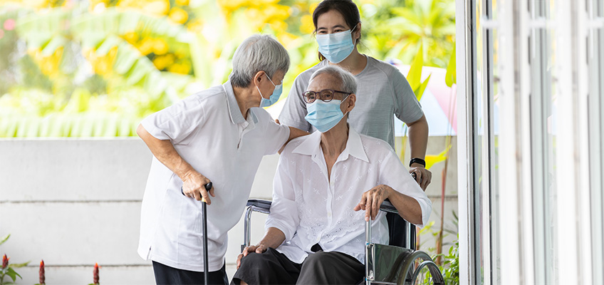 Seniors wearing masks with healthcare workers