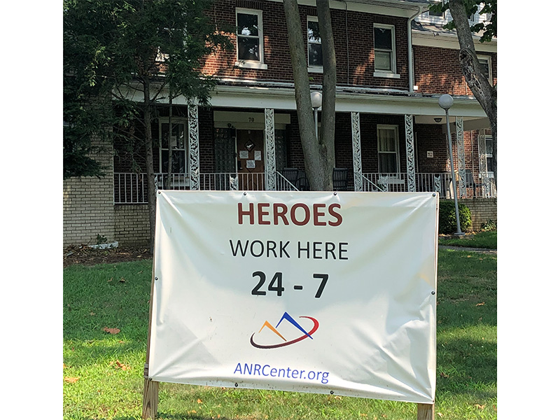 Heroes work here 24/7 sign in front of the building.