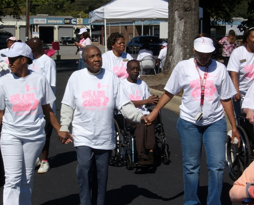 Some employees walking to support the awareness of breast cancer