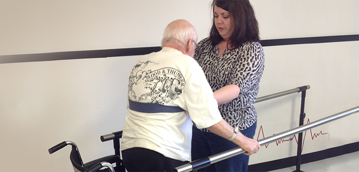 A nurse helping a resident walk