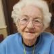 An elderly female veteran smiling