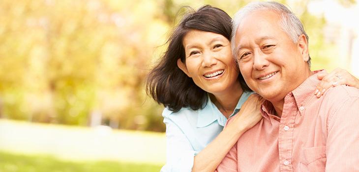 An elderly couple posing