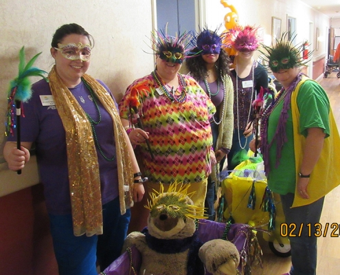 Group of nurses posing with vibrant masks