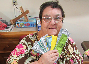 A resident showing off her monopoly money