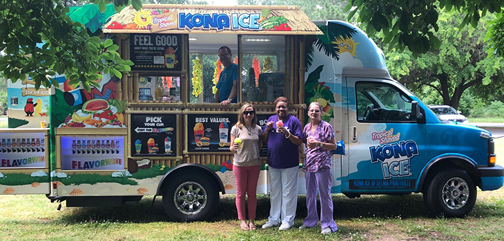 Three nurses enjoying Kona ice shaved ice