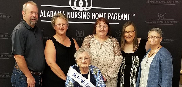 A group of nurses and a resident posing at the pageant