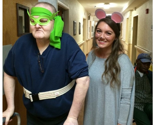 Nurse dressed as a mouse and a resident dressed as a ninja turtle