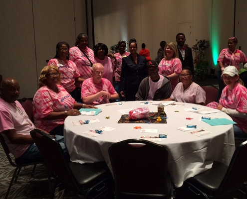 Staff all dressed in pink t-shirts to Stand Against Breast Cancer