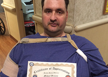 A resident showing off his appreciation award
