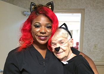 A nurse and a resident both in cat costumes