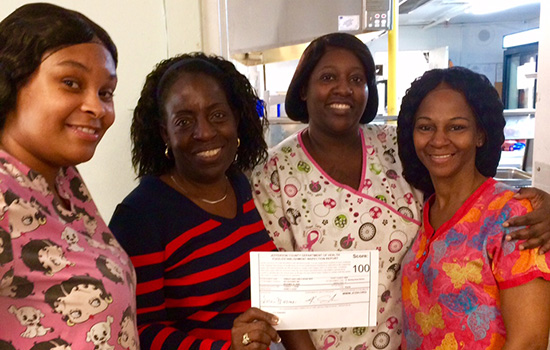 A group of nurses showing off their award