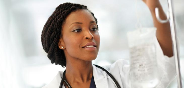 A nurse checking an I V bag