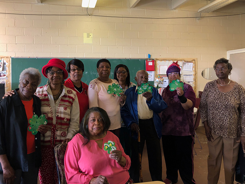 A large group of residents showing off their completed decoration projects