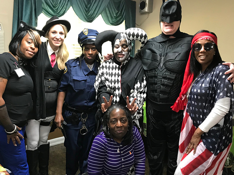 Staff dressed up for Halloween in a variety of costumes