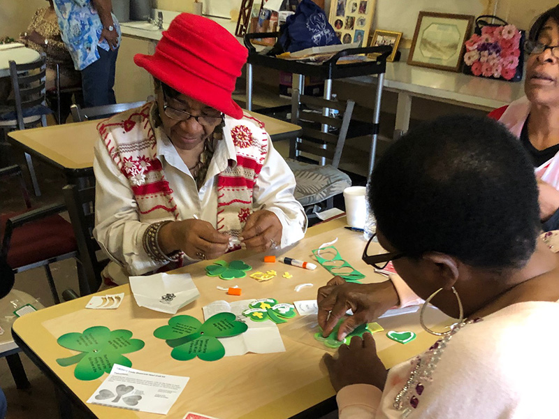 Residents working on St. Patrick's Day decorations