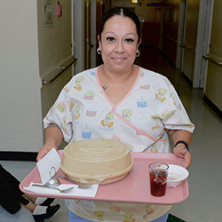 nurse holding a tray of food