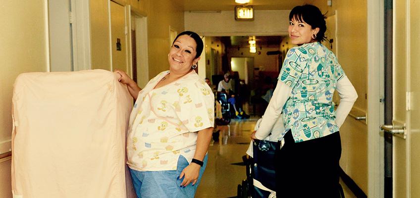 two nurses inside a hallway