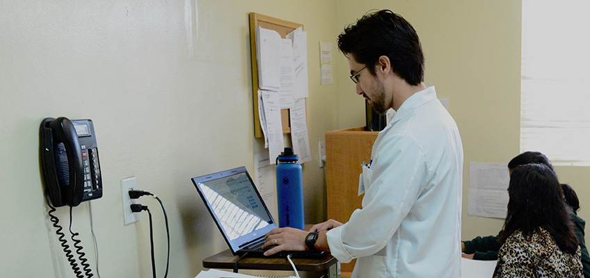 doctor working on a computer