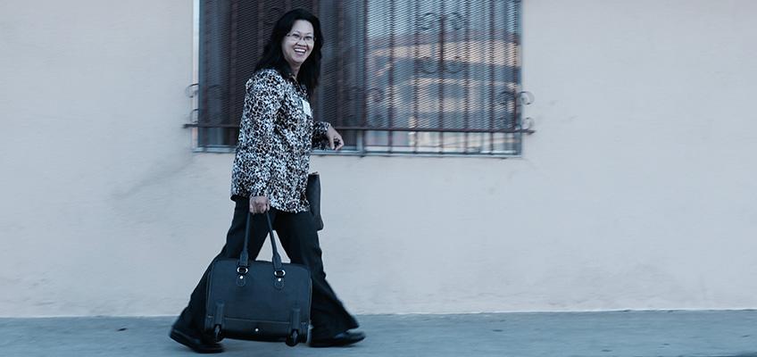 woman walking on the sidewalk