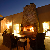 Crackling stacked stone outdoor fireplace and comfortable outdoor seating